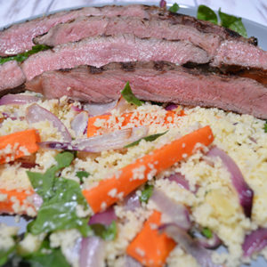 Grilled beef with carrot and couscous salad